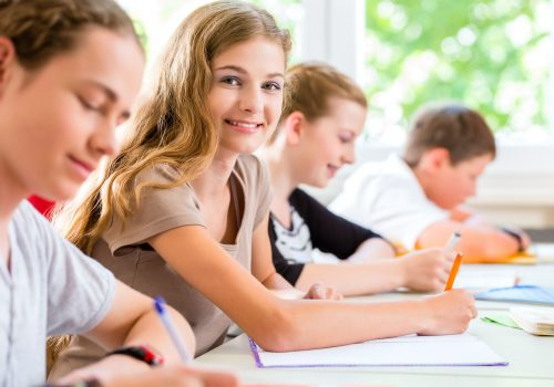 https://www.beylikduzuamerikankoleji.com/wp-content/uploads/2018/02/26449926-Students-or-pupils-of-school-class-writing-an-exam-test-in-classroom-Stock-Photo-500x350.jpg