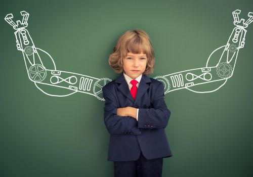 https://www.beylikduzuamerikankoleji.com/wp-content/uploads/2018/02/46594448-Kid-with-drawn-robot-hands-against-blackboard-Schoolchild-in-Stock-Photo-500x350.jpg